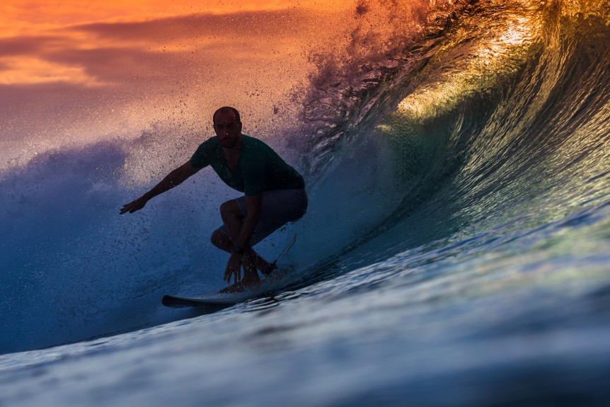 Surfer on Amazing Wave at sunset time, Bali island.
